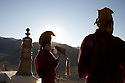 Monks blow Conch Shells to call monks to prayer in the early morning at Thiksey Monastery, Ladakh, India.
