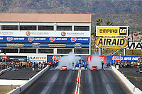 Feb 21, 2015; Chandler, AZ, USA; NHRA pro stock driver Drew Skillman (left) burns out alongside Erica Enders-Stevens during qualifying for the Carquest Nationals at Wild Horse Pass Motorsports Park. Mandatory Credit: Mark J. Rebilas-