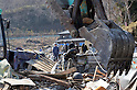 April 1st, 2011, Yamadamachi, Japan - Residents watch a heavy machine break up their damaged houses in Yamadamachi, Iwate Prefecture, on April 1, 2011, three weeks after this otherwise sleepy northeastern Japanese fishing village was devastated by a magnitude 9.0 earthquake and ensuing tsunami. (Natsuki Sakai/AFLO) [3615] -mis-.