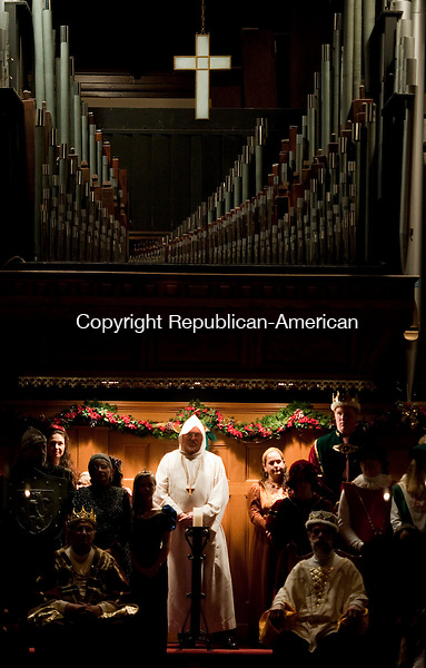 WINSTED, CT-010414JS06- The Friar, played by Gary Storrs, is illuminated during the 24th Annual Boar's Head Festival Saturday at the First Church of Winsted. The even continues with a show today (Sunday) at 4 p.m. Tickets are still available at the door.  Jim Shannon Republican-American