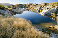 Looking down on the Blue Lake at St Bathans in late afternoon sunlight, Central Otago, South Island, New Zealand - stock photo, canvas, fine art print