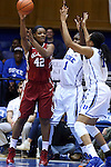 17 December 2014: Oklahoma's Kaylon Williams (42) is guarded by Duke's Elizabeth Williams (1) and Azura Stevens (11). The Duke University Blue Devils hosted the University of Oklahoma Sooners at Cameron Indoor Stadium in Durham, North Carolina in a 2014-15 NCAA Division I Women's Basketball game. Duke won the game 92-72.