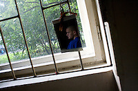 Tolya, 18, sits on his bed at Botkin Hospital in St. Petersburg, Russia, on Wednesday, September 12, 2007. Tolya uses heroin and is HIV-positive, but because he lives in Syevolosk, near St. Petersburg, rather than in the city proper, he is not entitled to free anti-retroviral medication to treat his HIV. Tolya is an orphan living with his uncle, who does not know Tolya has HIV.