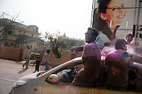 Indian people celebrating Holi on a road in Vrindavan. Holi is the Hindu festival of colours. Every year at the begining of spring this festival takes place throughout India.The biggest celebration takes place in Banke Bihari temple Vrindavan.
