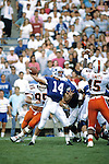 Ty Detmer goes back for a pass in the 1990 opener vs Miami.<br /> <br /> 14 Ty Detmer Quarterback.<br /> <br /> Sept. 1990<br /> FTB 9009 561<br /> <br /> Photo by Mark Philbrick/BYU