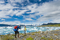 Tourists by icebergs from Columbia glacier in Columbia Bay, Prince William Sound, Alaska