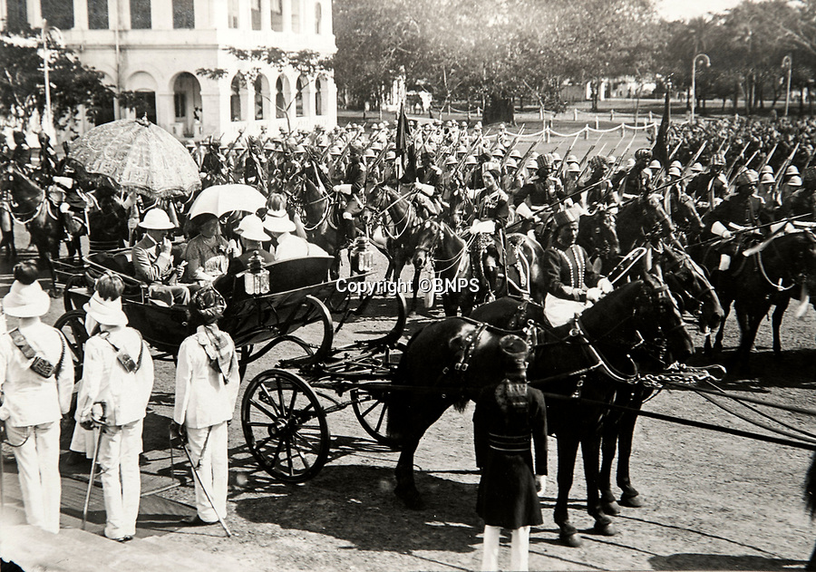 BNPS.co.uk (01202 558833)<br /> Pic: PhilYeomans/BNPS<br /> <br /> Looking like a Hollywood movie scene - Viscount Goschen arrives at Governers House in Madras 1924 - In front of his mounted Governer's Bodyguard.<br /> <br /> Last Days of the Raj - A fascinating family album from one of the last Viceroy's of India reveal Britain's 'Jewel in the Crown' in all its splendour.<br /> <br /> The family album of Viscount George Goschen has been unearthed after 90 years, and provide's an amazing snapshot of the pomp and pageantry of a wealthy and powerful British family in India in the 1920s and 30's.<br /> <br /> They show the Governor of Madras and his family enjoying a lavish lifestyle of parades, banquets and hunting and horse racing in the last decades of the Raj.<br /> <br /> At the time, Gandhi was organising peasants, farmers and labourers to protest against excessive land-tax and discrimination. <br /> <br /> The album consists of some 300 large photographs. They have remained in the family for 90 years but have now emerged for auction following a house clearance and are tipped to sell for &pound;200.