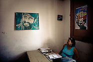 A Cuban office worker watches a painted portrait of the revolutionary leader Fidel Castro, hung on the wall of the Cuban state office in Santiago de Cuba, Cuba, 31 July 2008. During the Cuban Revolution, an armed rebellion at the end of the 1950s in Cuba, most of the revolutionary leaders started as no-name soldiers fighting in the jungle. Although the revolutionary leaders, after taking over the power, became autocratic rulers holding almost absolute power and putting the opposition in jail, for some reason Cuban people have never stopped to worship Fidel Castro, Che Guevara, Raul Castro and others. Cubans hang their photos and portraits on the wall in homes, shops and working places even they don't have to. The people of Cuba love their heroes.