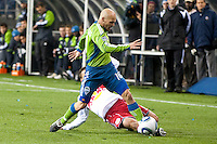 Freddie Ljungberg (r) and Seth Stammler (l) battle as the Seattle Sounders lost to the New York Red Bulls, 1-0, in an MLS match on Saturday, April 3, 2010 at Qwest Field in Seattle, WA.