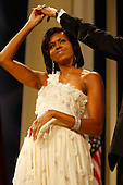 Washington, DC - January 20, 2009 -- First Lady Michelle Obama attends the Biden Home States Ball at the Washington Convention Center on January 20, 2009 in Washington, DC. Obama became the first African-American to be elected to the office of President in the history of the United States..Credit: Chip Somodevilla - Pool via CNP