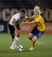 Shannon Boxx (7) of the USWNT fights to get to the ball with Lisa Dahlkvist (17) of Sweden at Rentschler Field in East Hartford, Connecticut.  The USWNT defeated Sweden, 3-0.