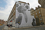 "Huge blow-up, by the French street artist JR, called the ""photograffeur"", Herdbrant Street, London"