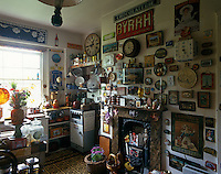 This corner of a small unmodernised kitchen displays an eccentric collection of objects