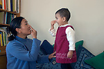 Berkeley CA Nepalese mother and daughter, nineteen-months-old, identifying and naming noses  MR