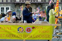 Loyalty day patriotic parade in small town USA. Vietnamese Americans float.