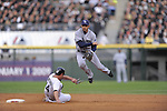 CHICAGO - October 6:  Jason Bartlett of the Tampa Bay Rays turns a double play over a sliding Paul Konerko during the game against the Chicago White Sox at U.S. Cellular Field in Chicago, Illinois on October 6, 2008.  The Rays defeated the White Sox 6-2 to advance to the ALCS.  (Photo by Ron Vesely)