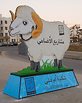 Amman, Jordan.  In the days leading up to the Feast of the Id el-Adha, ending the holy month of Ramadan, Amman  streets are adorned with large signs offering sheep for sale, to be sacrificed at the Id and then donated to feed the poor, according to Islamic custom.  © Rick Collier