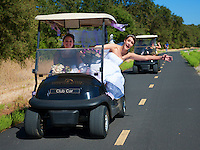 Bride heads to her wedding in a golf cart at Morgan Creek Golf Course, Roseville, CA.