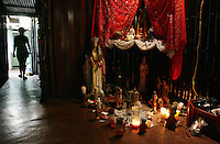 A priestess called Luisa at the ceremony place she has in her home near Sorte Mountain in yaracuy, the center of popular religions in Venezuela.