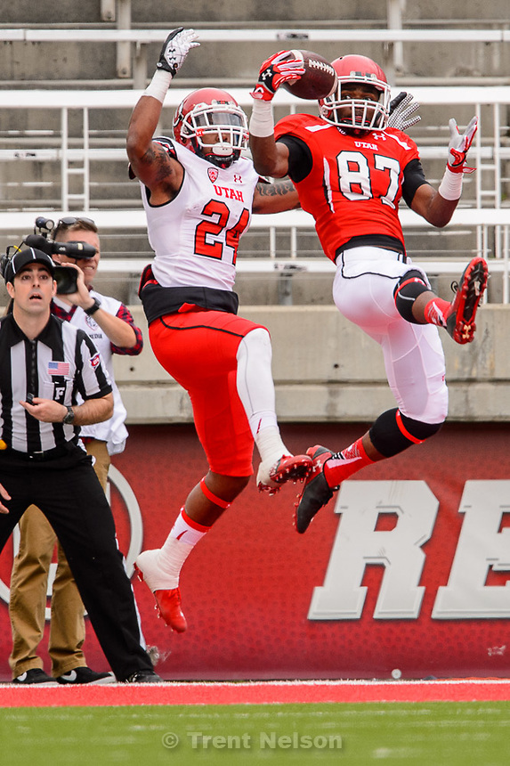 Trent Nelson  |  The Salt Lake Tribune<br /> Jawuan Mathis pulls in an end zone interception ahead of Kenric Young at the Utah Football Red &amp; White game in Salt Lake City, Saturday April 25, 2015.