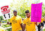 Waterbury, CT- 21  May 2017-052117CM02-  Ryan Gomes, left, CEO of Hoops For Heart Health and D.J Dublin of Wolcott take part in the Greater Waterbury Interfaith Ministries' annual Hunger Walk on Sunday.  Approximately 250 people marched around city in support of ending hunger.  GWIM provides hot meals and food services in the area to those who are less than fortunate.      Christopher Massa Republican-American