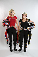 Feb. 22, 2013; Chandler, AZ, USA; NHRA funny car driver Courtney Force (left) and sister Brittany Force pose for a portrait prior to qualifying for the Arizona Nationals at Firebird International Raceway. Mandatory Credit: Mark J. Rebilas-