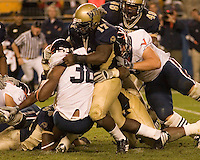 Pitt linebacker Clint Session (17) roughs up Virginia running back Jason Snelling.  The Pitt Panthers defeated the Virginia Cavaliers 38-13 on September 02, 2006 at Heinz Field, Pittsburgh, Pennsylvania.