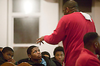 New York, USA - Reverend Stephen Pogue (R, standing) preaches during hip-hop mass at the Greater Hood Memorial AME Zion Church, home of the Hip-Hop Church, in Harlem, New York, USA, 17 March 2005. Photo Credit: David Brabyn.