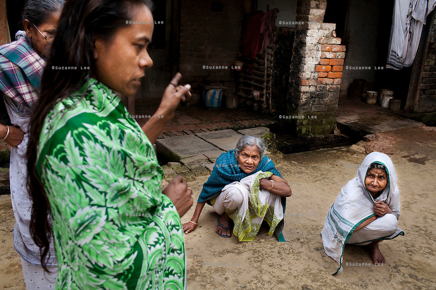 "(L-R: Purnima Mandol, 36, in green; Saraswati Saha, 84, blue shawl; and Kamla Das, 90, white sari) Refugees of The Partition gather and discuss their unfortunate situation outside their homes in Cooper's Camp, Nadia district, Ranaghat, North 24 Parganas, West Bengal, India, on 19th January, 2012. ""I was born here, but I spent my entire life growing up as a refugee. I grew up standing in line for government handouts."" says Purnima angrily. Over 60 years after the bloody creation of Bangladesh in 1947, refugees who fled what was then known as West Pakistan to India still live as refugees. .Photo by Suzanne Lee for The National (online byline: Photo by Szu for The National)"