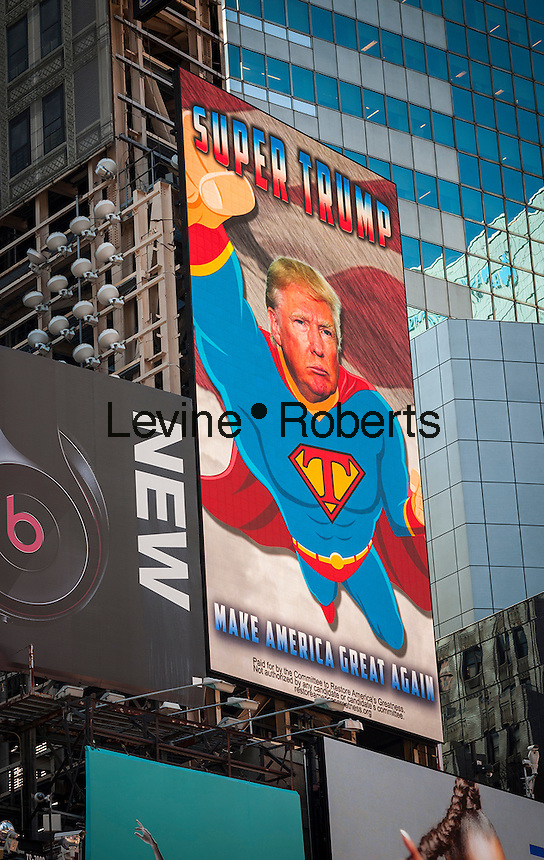 """An electronic billboard promoting the Donald Trump presidential campaign in Times Square in New York on Thursday, September 15, 2016. The animated display, showing Trump as """"Super Trump"""" ,was paid for by the Committee to Restore America's Greatness which has no affiliation with the candidate. The four-day advertising campaign is also being shown along I-4 in Central Florida. (© Richard B. Levine)"""