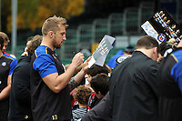 Dominic Day of Bath Rugby signs autographs at the end of the session. Bath Rugby Captain's Run on October 30, 2015 at the Recreation Ground in Bath, England. Photo by: Patrick Khachfe / Onside Images