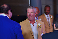 Canton, OH - August 6, 2016: Former NFL player Brett Favre chats with David Baker, President of the Pro Football Hall of Fame, backstage after giving his speech at the Pro Football Hall of Fame Enshrinement Ceremony in Canton, Ohio, August 6, 2016.  Favre played 20 seasons in the NFL and retired as the NFL's all-time leading passer with 6,300 completions, 10,169 attempts, 71,838 yards and 508 TDs(Photo by Don Baxter/Media Images International)