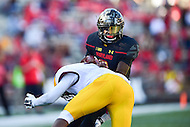 College Park, MD - OCT 15, 2016: Maryland Terrapins quarterback Tyrrell Pigrome (3) is tackled by Minnesota Golden Gophers defensive back Damarius Travis (7) during game between Maryland and Minnesota at Capital One Field at Maryland Stadium in College Park, MD. (Photo by Phil Peters/Media Images International)