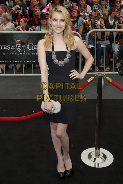 """EMMA ROBERTS.Premiere of """"Pirates of the Caribbean : On Stranger Tides"""" held at Disneyland in Anaheim, California, USA, May 7th 2011..4 four full length strapless dress hand on hip clutch bag black necklace silver white hand on hip peep toe shoes .CAP/CEL .©CelPh/Capital Pictures."""
