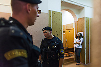 17/08/2012, Moscow, Russia..Bored special forces police and officials outside the courtroom listen to the verdict being read through a loudspeaker as Maria Alyokhina, Yekaterina Samutsevich and Nadezhda Tolokonnikova of punk band Pussy Riot are sentenced to two years in prison for their performance in the Christ The Saviour Cathedral.