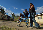 Tarisayi Zhanje pushes her grandson, Hailey Kushaya, in a walker at their home in Harare, Zimbabwe. She cares for the 9 year old since his parents died. At school he uses an appropriately-designed and fitted wheelchair provided by the Jairos Jiri Association with support from CBM-US.