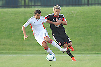 Juan Toja (7) of the New England Revolution shields the ball against Nick DeLeon (18) of D.C. United. D.C. United defeated the The New England Revolution 3-1 in the Quarterfinals of Lamar Hunt U.S. Open Cup, at the Maryland SoccerPlex, Tuesday June 26 , 2013.
