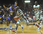 "Ole Miss guard Chris Warren (12)  is fouled by Louisiana State's Andre Stringer (10) at the C.M. ""Tad"" Smith Coliseum in Oxford, Miss. on Wednesday, February 9, 2011. Ole Miss won 66-60 and is now 4-5 in the Southeastern Conference."