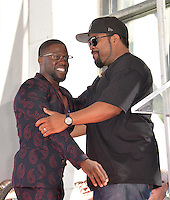 LOS ANGELES, CA. October 10, 2016: Kevin Hart &amp; Ice Cube at the Hollywood Walk of Fame Star Ceremony honoring comedian Kevin Hart.<br /> Picture: Paul Smith/Featureflash/SilverHub 0208 004 5359/ 07711 972644 Editors@silverhubmedia.com