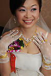 Taiwanese Wedding -- The bride, proudly showing off her jewelry.