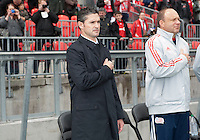 Toronto, Ontario - May 3, 2014: New England Revolution head coach Jay Heaps during the opening ceremonies in a game between the New England Revolution and Toronto FC at BMO Field.<br /> The New England Revolution won 2-1.