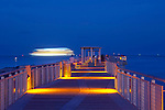Recently renovated South Pointe Park Pier in Miami Beach, Florida.  A cruise ship is a blur of light as it leaves Miami at dusk.