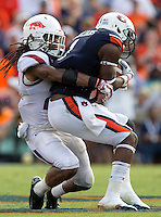 HAWGS ILLUSTRATED JASON IVESTER --08/30/2014--<br /> Arkansas senior safety Alan Turner makes a tackle on Auburn junior wide receiver D'haquille Williams following a reception on Saturday, Aug. 30, 2014, against Auburn at Jordan-Hare Stadium in Auburn, Ala.