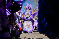 Victor Harris, Big Chief of the Fi Yi Yi, dances in the Treme neighborhood of New Orleans on Mardi Gras day, February 16, 2010.
