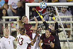 06 December 2013: Florida State goalkeeper Kelsey Wys (far right) leaps to claim the ball over Virginia Tech's Ashley Meier (15) and Shannon Mayrose (4 red). The Florida State Seminoles defeated the Virginia Tech University Hokies 3-2 at WakeMed Stadium in Cary, North Carolina in a 2013 NCAA Division I Women's College Cup semifinal match.