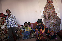 November 22, 2014 - Murzuq City, Libya: A Tebu family displaced from Ubari battleground is seen inside a temporary shelter outskirst Murzuq. Fighting around Southwest Ubari region ignited after Tuareg militias from Mali and Libya sized control over the vast oilfield installations aligned with the Third Force of Misrata armed forces. Since then raged battles have taken place between two factions: one faction of Tuareg fighters lead by Third Force from Misrata pushing to clean the region from the other faction of Tebu tribal fighters defending their controlled territory. (Photo/Narciso Contreras)
