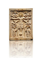 Medieval elephant ivory plaque with traces of paint made in Italy in the 13th or start of the 14th century.  The crucifixion is a rare example of a Gothic piece being inspired by 11th century Romanesque works.  inv 7268, The Louvre Museum, Paris.