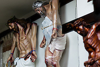 Jesus Christ crucified statue, foil-wrapped and ready for sale, seen in a religious shop in Bogota, Colombia, May 27, 2010. About 80% of the population in Colombia identify themselves as followers of the Catholic religion. Colombians are among the most devout of Latin American Catholics. Colombian Catholic church is renowned as one of the most conservative and traditional in Latin America, having traditionally been associated with elite structures in the society.