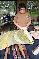 Artist Roen Hufford unrolls and shares finished tapa (or kapa), which she has dyed with several native plants for color, Big Island.