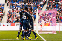 Mike Magee (9) of the Chicago Fire celebrates scoring with teammates  during the first half against the New York Red Bulls during a Major League Soccer (MLS) match at Red Bull Arena in Harrison, NJ, on October 27, 2013.
